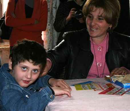 Home visit with the family of a child with cerebral palsy