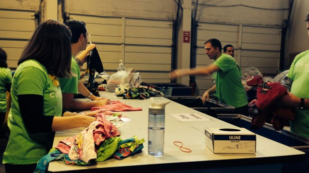 The volunteers are showing sorting goods into categories for further organizing.