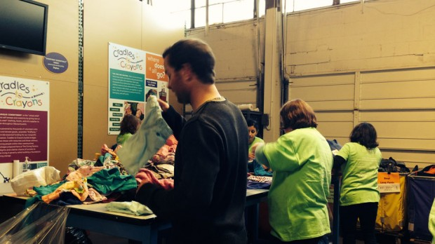 Volunteers organizing received goods.