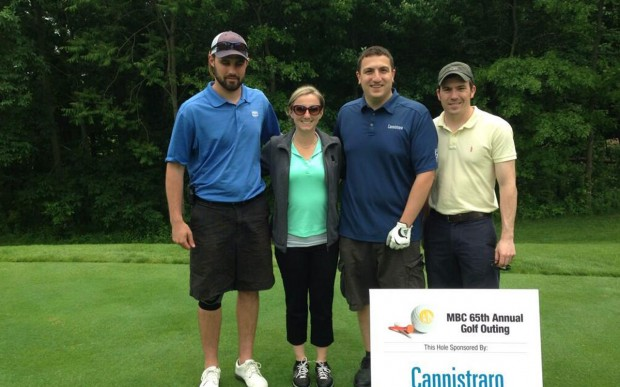Maria poses with her golfing partnerss