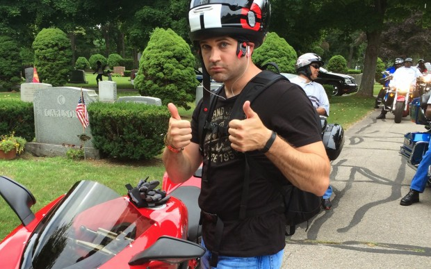 Jason with his motorcycle.