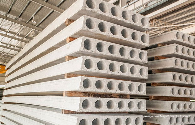 Building with precast hollow core plank